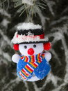 Christmas snowman on pine tree stock photos funny toy ornament snow and needles background outdoors Stock Images