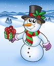 Christmas snowman in snowy Royalty Free Stock Photo