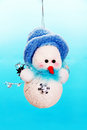 Christmas snowman toy photo on a blue background Royalty Free Stock Images