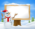 Christmas Snowman and Winter Sign Royalty Free Stock Photography