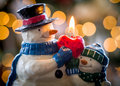 Christmas snowmen candle at xmas snowman in front of defocus tree lights Royalty Free Stock Photo