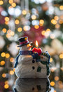 Christmas snowmen candle at xmas snowman in front of defocus tree lights Royalty Free Stock Photography