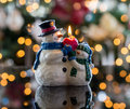 Christmas snowmen candle at xmas snowman in front of defocus tree lights Stock Photos