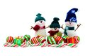 Christmas snowmen cute toy with baubles and candy canes over white Royalty Free Stock Images