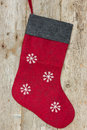 Christmas sock hung on the wooden wall Stock Image