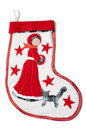 Christmas sock with a snow white homemade stitch cat shawl and red star on background Stock Photo
