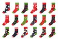 Christmas socks. Cartoon trendy flat clothing element and winter celebration attributes with patterns and ornaments Royalty Free Stock Photo