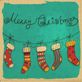 Christmas socks hand drawn illustration hanging with snowflakes and grunge frame on old paper background Stock Photo