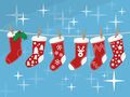 Christmas socks hanging on rope  Royalty Free Stock Image