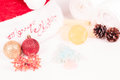Christmas spa getaway with baubles bath salts and soaps close up Royalty Free Stock Images