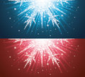 Christmas sparkles in a shape of snowflake on blue and red background Royalty Free Stock Photos