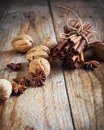 Christmas spices cinnamon sticks star anise and walnuts on wooden table Royalty Free Stock Image