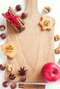 Christmas spices, nuts on cutting board Royalty Free Stock Photo