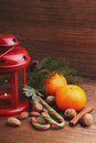 Christmas spirit: nuts, tangerines, Christmas tree, nuts, a flashlight Royalty Free Stock Photo