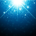 Christmas star abstract holiday background with light in blue Stock Image