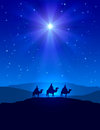 Christmas star on blue sky and three wise men