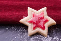 Christmas star cookies with red jelly and powder sugar Stock Image