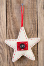 Christmas star decoration hanging against wooden background Stock Images