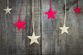Christmas star decoration on wooden textured background Royalty Free Stock Images