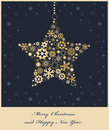 Christmas star from golden snowflakes Stock Photo