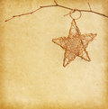 Christmas star hanging over old old paper decoration background Royalty Free Stock Photography