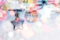 Christmas star and holiday lights hanging on blurred silver back Royalty Free Stock Photo