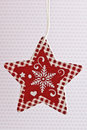 Christmas star ornament red and white paper Stock Images