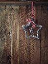 Christmas star rustic on a wooden wall Stock Photos