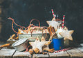 Christmas star shaped cookies, decoration rope, nuts, spices, milk bottles Royalty Free Stock Photo