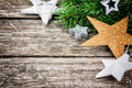 Christmas stars in festive setting on wooden background Royalty Free Stock Image