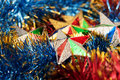 Christmas stars in multicolored tinsel decoration holiday decoration Royalty Free Stock Photography