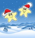 Christmas stars on starry sky Stock Images