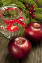 Christmas still life with apples and candle holder card bright colorful decoration Stock Photo