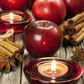 Christmas still life with apples and candle holder spices Royalty Free Stock Photos