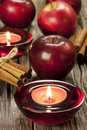 Christmas still life with apples composition candle holder and Stock Photo
