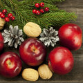 Christmas still life with apples fir tree branch Royalty Free Stock Image