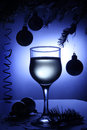 Christmas still life with beverage decorations wineglass and xmas balls on the table Stock Photos