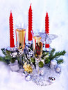 Christmas still life with champagne and candle. Royalty Free Stock Photography