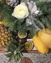 stock image of  Christmas still life of fir branches and fruits