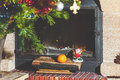 Christmas still life in fireplace. Christmas tree, tangerine, Santa Claus Royalty Free Stock Photo