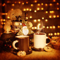 Christmas still life image of beautiful christmastime traditional gingerbread with coffee cups on the table teddy bear with Royalty Free Stock Image
