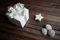 Christmas still life image of three spice cakes and decorative white star with giftbox near by Stock Photo