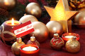 Christmas still life made from golden boxes and balls on red fabric shallow depth of field Stock Image