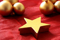 Christmas still life made from golden boxes and balls on red fabric shallow dof Royalty Free Stock Images