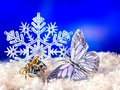 Christmas still life with snowflake and candle. Royalty Free Stock Images