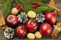 Christmas still life with walnuts and apples composition red Stock Images