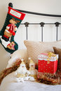 Christmas stocking on bed cozy home at time with present the Royalty Free Stock Photo