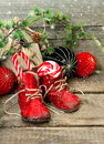 Christmas stocking festive nostalgic decoration with antique toys and vintage baby shoes over wooden background retro style Stock Photo