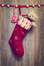 Christmas stocking filled with teddy bear with vintage feel Stock Photo