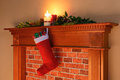 Christmas stocking fire glow a full of gifts hanging from a mantelpiece lit by the from the fireplace on day Stock Photos